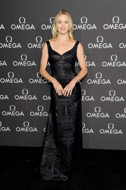 Actress Yvonne Strahovski completes her look with the Stack clutch in gunmetal by LEE SAVAGE while attending the 45th Anniversary of the Apollo 13 Mission at the Western Airways Airport Hangar in Sugar Land, Texas in April 13th, 2015.