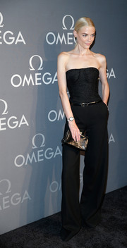 Jaime King paired her outfit with an elegant black crocodile clutch.
