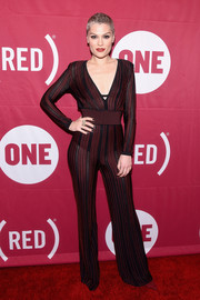 Jessie J ravished in a sheer striped jumpsuit by Balmain at the ONE Campaign and (RED) concert to mark World AIDS Day.