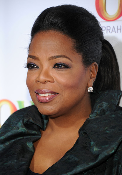 Oprah Winfrey looked sassy at the 2011 TCA Winter Press Tour cocktail party with her hair in a pompadour ponytail.