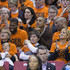 (AFP OUT) President Barack Obama (C) sits with his  brother-in-law Craig Robinson (R), his nephew Avery Robinson (2-L) and daughter Malia (L) while attending the Green Bay versus Princeton women's college basketball game in the first round of the NCAA tournament, March 21, 2015 in College Park, Maryland. President Barack Obama's niece Leslie Robinson plays for Princeton.