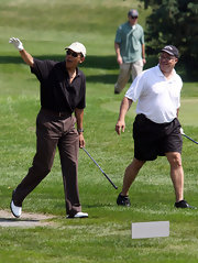 Barack sticks with sporty sunglasses on the golf course.