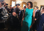 Michelle Obama exuded retro charm in a bow-adorned turquoise sheath dress at the 2010 National Medal of Arts and National Humanities Medal ceremony.