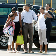 Michelle Obama complemented her neutral outfit with a neon-yellow canvas tote during a trip to Martha's Vineyard.