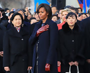 A pair of red patent leather gloves provided a nice splash of color to Michelle Obama's look during the arrival ceremony for the Chinese President.