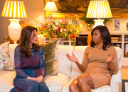 Michelle Obama opted for a simple nude crewneck sweater when she attended a dinner at Kensington Palace.