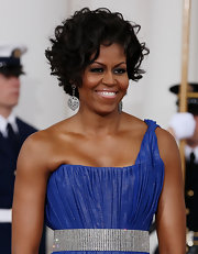 And why shouldn't the First Lady of the United States wear sapphires and diamonds to the State Dinner? Michelle's earrings are just like her—classic and modern at once.