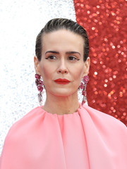 Sarah Paulson complemented her pink dress with a pair dangling gemstone earrings by Irene Neuwirth.