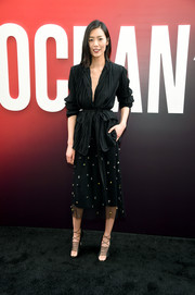 Liu Wen styled her look with a pair of black lace-up heels.