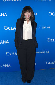 Mary Steenburgen teamed a black pantsuit with a white ruffle blouse for the Oceana: Sting Under the Stars event.