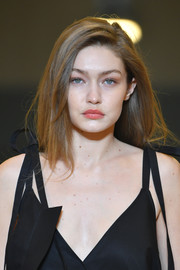 Gigi Hadid walked the Off-White runway wearing a loose side-parted 'do.