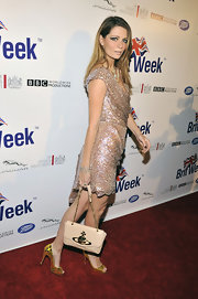 Mischa Barton attended the launch of BritWeek 2012 wearing a pair of bright and shiny metallic gold peep toe pumps.