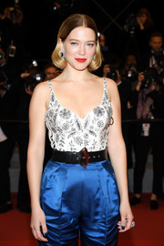 Lea Seydoux teamed a broad black belt with blue satin trousers and an embellished top for the Cannes Film Festival screening of 'Oh Mercy!'