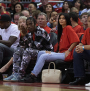 Kylie Jenner dressed down in a red tee and ripped blue jeans for game five of the Western Conference Quarterfinals.