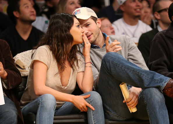 More Pics of Mila Kunis V-Neck Tee (1 of 4) - Tops Lookbook - StyleBistro [people,audience,crowd,event,interaction,sitting,finger,gesture,conversation,jeans,actors,ashton kucher,user,user,mila kunis,note,los angeles,oklahoma city thunder,los angeles lakers,game]