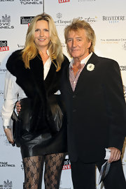 Penny Lancaster topped her white button-down shirt with a fur vest to match her black skirt.