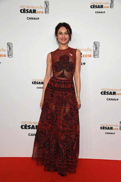 Olga Kurylenko Sheer Dress [red carpet,clothing,dress,carpet,fashion model,fashion,flooring,premiere,cocktail dress,fashion design,red carpet arrivals - cesar film awards,paris,france,salle pleyel,le fouquet,olga kurylenko]