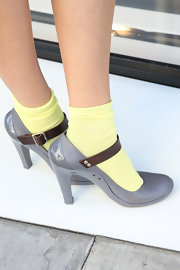 Olga Sorokina paired neon yellow socks with gray pumps for a fun and girlie look while visiting LA.