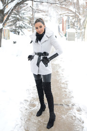 Olivia Culpo sealed off her cold-weather look with a pair of black thigh-high boots by Nicholas Kirkwood.
