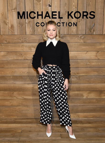 Olivia Holt Crop Top [clothing,pattern,fashion,polka dot,street fashion,design,footwear,trousers,black-and-white,olivia holt,front row,new york city,michael kors fw20 runway show,bella hadid,new york fashion week,runway,new york,fashion week,fashion,fashion show,model,beauty]