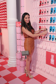 Olivia Munn accessorized with a tasseled gray shoulder bag by Mossimo when she attended the opening of Target Tribeca.