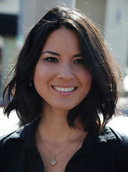 Olivia Munn wore her adorable 'do casually tousled at the unveiling of her new PETA billboard in Los Angeles.