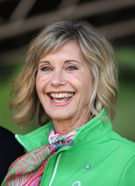 Olivia Newton-John Short Wavy Cut [face,hair,green,blond,smile,skin,chin,wrinkle,portrait photography,photography,olivia newton-john attends annual wellness walk and research run,olivia newton-john,wellness programs,wellness walk and research runon,cancer research,funds,australia,melbourne,olivia newton-john cancer wellness and research centre,event]