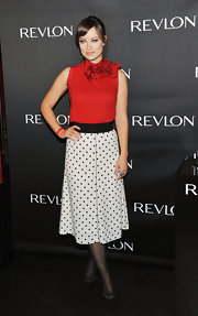 Olivia Wilde channeled retro style in a polka-dotted frock. She topped off the look with black suede Mary Jane pumps.
