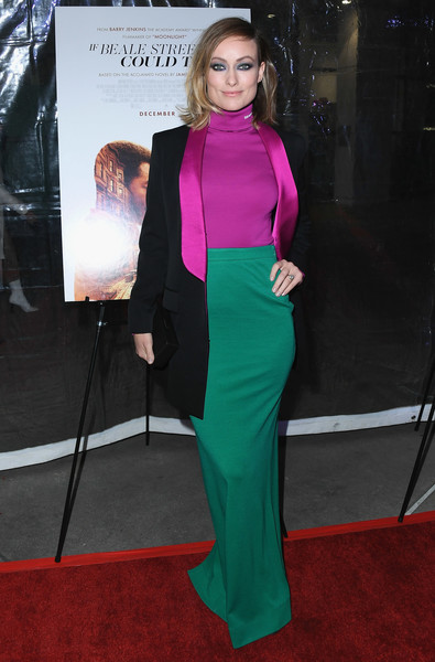 Olivia Wilde Long Skirt [clothing,red carpet,carpet,shoulder,dress,premiere,fashion,flooring,neck,magenta,arclight hollywood,california,los angeles special screening of ``if beale street could talk,arrivals,olivia wilde]