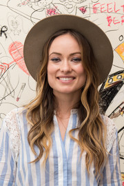 Olivia Wilde attended the launch of Edward Sharpe and the Magnetic Zeros' new music video looking hippie-chic with her long wavy hairstyle.