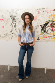 Olivia Wilde was casual and cute in a blue and white striped blouse while unveiling Edward Sharpe and the Magnetic Zeros' new music video.