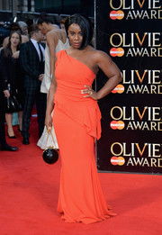 Uzo Aduba brightened up the Olivier Awards red carpet with this orang peplum one-shoulder gown.