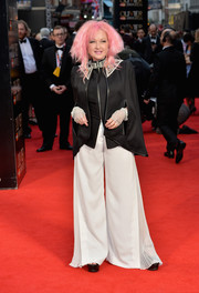 Cyndi Lauper completed her outfit with white wide-leg pants.