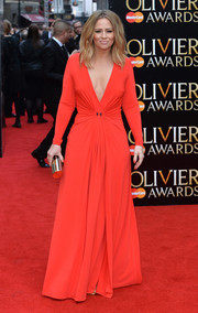 Kimberley Walsh was sexy and sophisticated at the Olivier Awards in a red Halston Heritage gown with a plunging neckline and ruching at the waist.