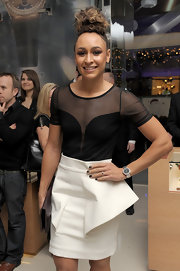 Jessica Ennis showed a hint of sexiness with this sheer-panel black top at the Omega store launch.