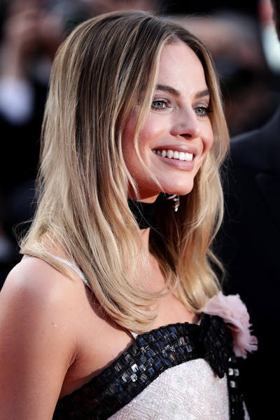 Margot Robbie wore her hair in a center-parted layered cut at the 2019 Cannes Film Festival screening of 'Once Upon a Time in Hollywood.'