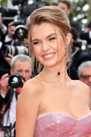 Josephine Skriver looked elegant with her loose French twist at the 2019 Cannes Film Festival screening of 'Once Upon a Time in Hollywood.'