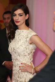 Anne Hathaway exhibits old Hollywood glamour at the 'One Day' European film premiere. With a deep side part and sleekness at the roots, Anne's perfect spiraling tendrils are always a classic look.
