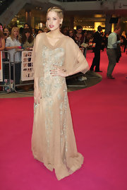 Peaches Geldof shined at the 'One Day' premiere in a blush crystal embellished tulle gown. She finished off the look with a bright red pout.