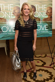 Nanette Lepore flashed some skin in a see-through mesh-panel top during the NYC screening of 'The One I Love.'