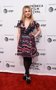 Juno Temple teetered on a pair of sky-high black sandals with rhinestone embellishments.