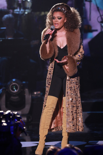 Andra Day cut a luxe figure at the 'One Voice: Somos Live!' concert wearing this embellished, fur-collar coat.