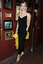 Stephanie March attended OneKid OneWorld Comedy Night wearing bold pops of yellow that included her buttery gold and black patterned pumps.