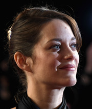 Marion Cotillard styled her hair into a classic French twist for the BFI London Film Festival screening of 'It's Only the End of the World.'