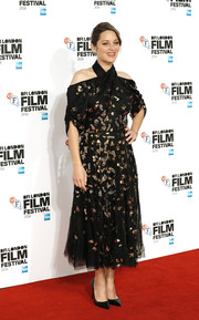 Marion Cotillard sparkled in a beaded black cold-shoulder dress by Dior Couture at the BFI London Film Festival screening of 'It's Only the End of the World.'