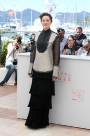 Marion Cotillard contrasted her menswear-inspired top with an ultra-girly tiered maxi skirt.