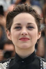 Marion Cotillard attended the Cannes photocall for 'It's Only the End of the World' sporting a messy updo.