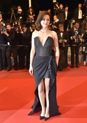 Marion Cotillard vamped it up in a strapless black Dior Haute Couture corset gown, featuring a deep-V plunge and a drapey high-low skirt, at the Cannes screening of 'It's Only the End of the World.'