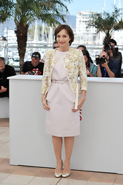 Kristin Scott Thomas looked summer ready in this blush pink day dress, which she paired with a floral collarless blazer.