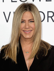 Jennifer Aniston accessorized with a simple gold eye pendant.